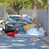 An abandoned car and illegally dumped items.