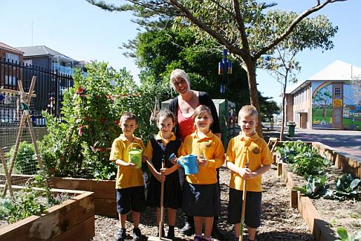 Students, teaches and parents all contribute to looking after the school's vegetable garden.