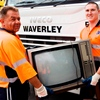Two Waverley council workers removing a tv