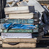 A pile of dirty mattresses
